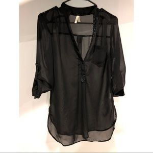 Black sheer top with beaded v cut